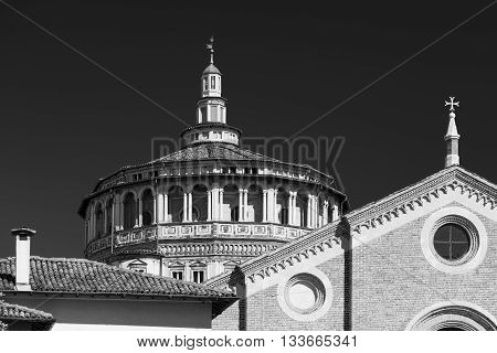 Exterior of the medieval church of Santa Maria delle Grazie in Milan (Lombardy Italy): facade and dome. Black and white