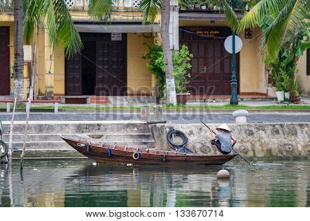 Unidentified woman on boats on Thu Bon river in ancient Hoian town. Hoian is recognized as a World Heritage Site by UNESCO