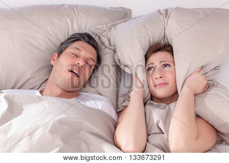 pillow embracing loud night for wife