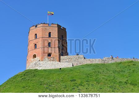 VILNIUS LITHUANIA - MAY 24: Gedimino Tower in Vilnius on May 24 2015 in Vilnius Lithuania. Gedimino Tower is an important state and historic symbol of the city of Vilnius and of Lithuania itself.