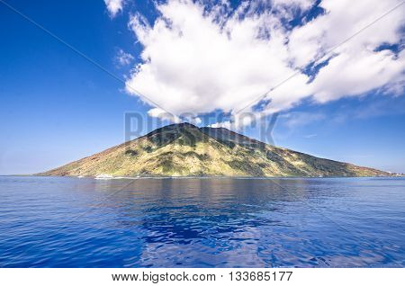 View from the boat of the Sicilian island in the summer , blue sea and waves of ships