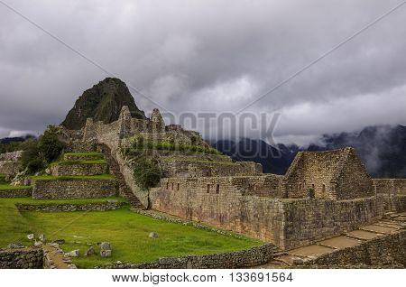 View Of Temple Ruins In Lost Inca City Of Machu Picchu. Low Clouds. Cusco Region,sacred Valley, Peru