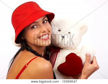 Happy pretty  woman with teddy bear