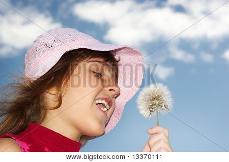 Little girl and dandelion