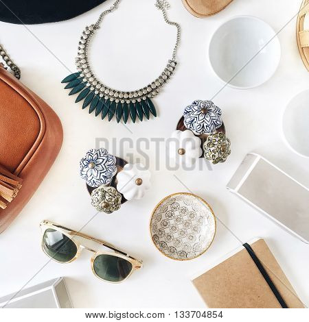 decorated with female jewelry isolated on white background. flat lay overhead view