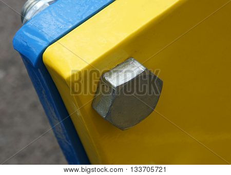 Connection of the painted metallic parts into a single structure with bolt and nut.