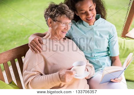 Caregiver And Senior In Garden