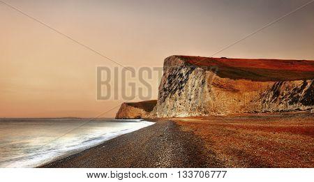 Durdle Door dramatic Jurrasic coastline Concept