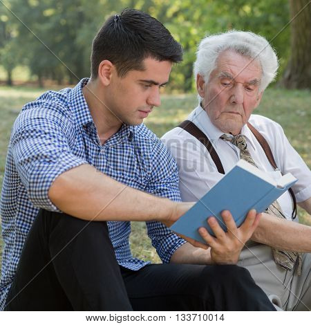 Grandparent and mature grandchild spending time togheter