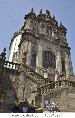 PORTO, PORTUGAL - AUGUST 10, 2016: People sitting in front of the Clerigos church in Porto Portugal