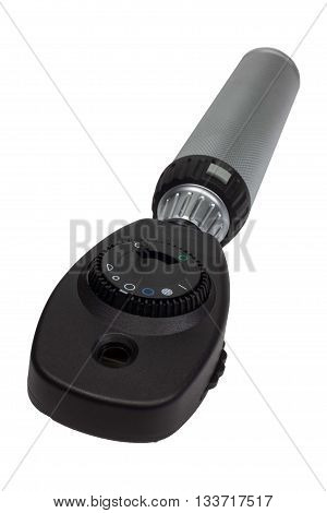 Ophthalmoscope with handle on white background. Medical equipment for the treatment of eye.