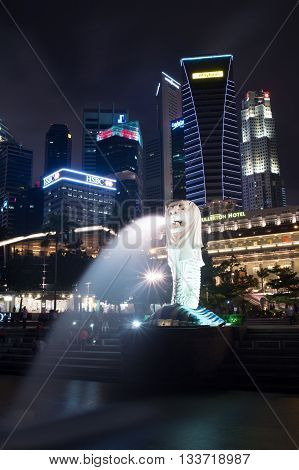 Singapore-jun 14, 2015: Singapore City Urban View With 8.5M-tall Merlion Statue In Merlion Park At M