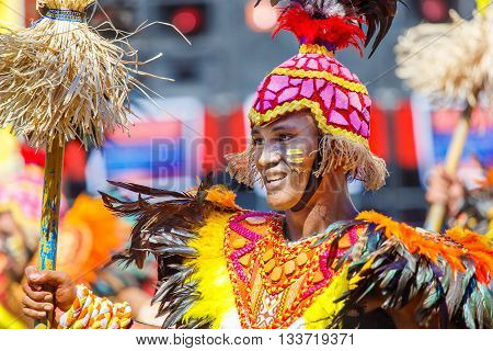 January 24th 2016. Iloilo Philippines. Festival Dinagyang. Unidentified people on parade in carnival costumes. Documentary Editorial Image.