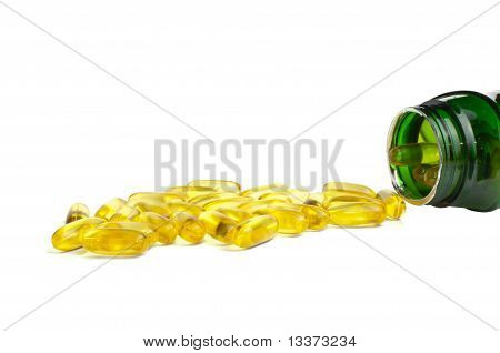 One bottle of omega 3 fish oil with capsules over white poster