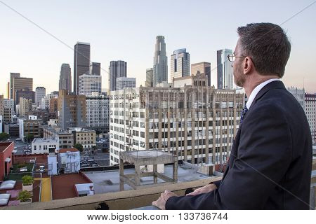 Businessman or architect looking at real estate gentrification zone of Downtown Los Angeles poster