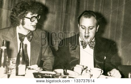 LODZ, POLAND, CIRCA 1970's: Vintage photo of two young men during a party