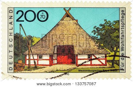 MOSCOW RUSSIA - JUNE 02 2016: A stamp printed in Germany shows Mecklenburgisches farmhouse series