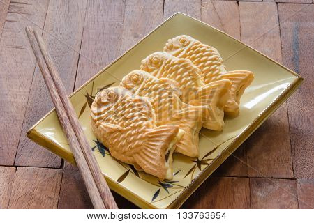 Taiyaki cakes on wood background Japanese confectionery