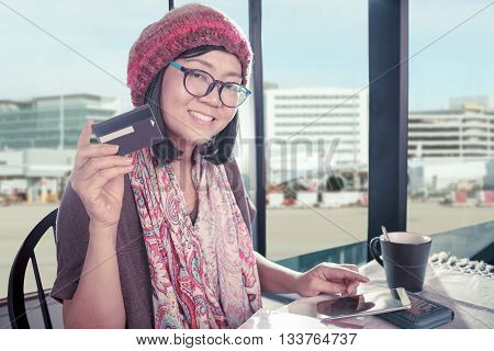 asian woman happiness smiling face with credit card in hand use for modern lifestyle on line shopping and pay by bank debit card