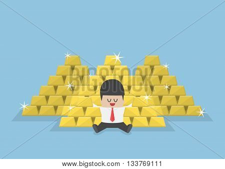 Businessman Sitting With A Pile Of Gold Bars