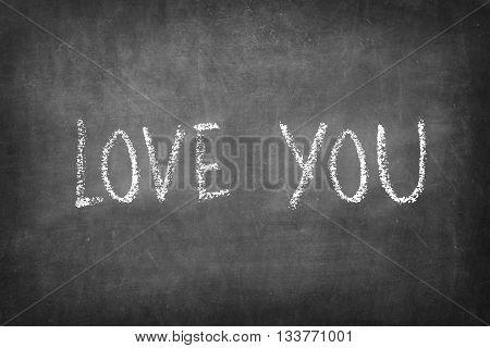 Love you chalk word on Blackboard background