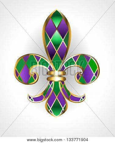 gold jewelry lily decorated with green and purple diamonds on a light background. Fleur de Lis. Fat Tuesday. Mardi Gras