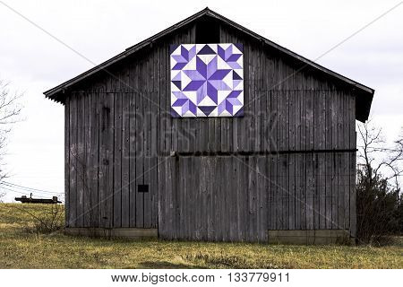 Quilt barn with purple quilt square design in rural Kentucky