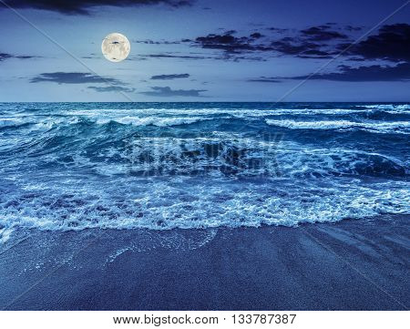 Sea waves Running On Sandy Beach At Night