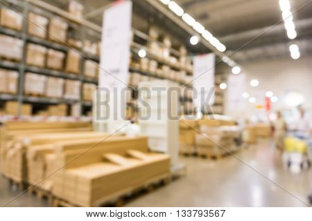Defocused Background Of Furniture Store Industrial Warehouse Row