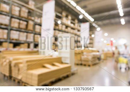 Defocused Background Of Furniture Store Industrial Warehouse Row
