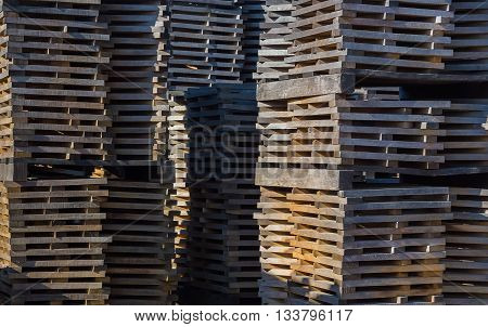 Oak planks for wine barrels stacked in piles elution of tannins on the open air