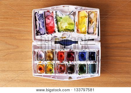 This is photo of brushes on watercolors