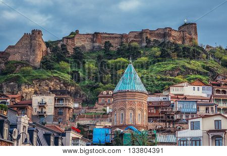 Tbilisi Georgia - April 24 2015. View on buildings on the Old Town of Tbilisi. Narikala Fortress on background