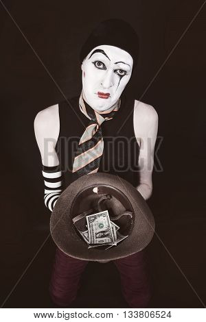 Mime With Hat In Hand Begging