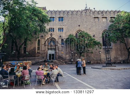 Barcelona Spain - May 22 2015. People sits in restaurant in front of Sant Pere de les Puelles Benedictine monastery in Barcelona