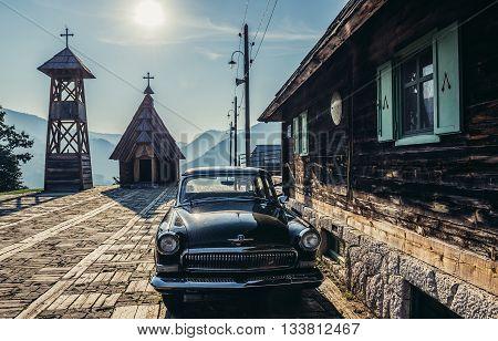 Drvengrad Serbia - August 28 2015. Old Volga car in front of wooden house of Drvengrad village built by Emir Kusturica