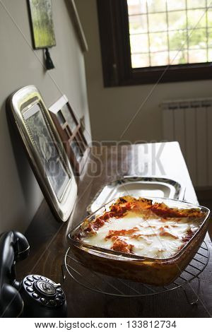 stuffed lasagne with mozzarella and tomato sauce in a glass bowl