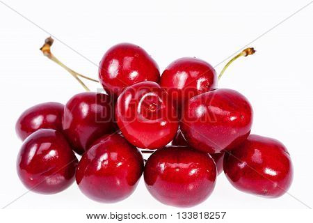 heap fruits of red cherry isolated on white background.