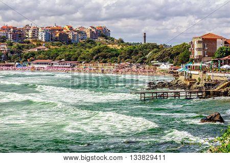 Morning Waves Near The City Beach