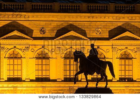 Horseman sculpture in Dresden (Germany) at night.