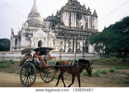 PAGAN / BURMA (NOW CALLED MYANMAR) - CIRCA 1987: A horse-drawn carriage passes by the Ananda Temple in Pagan.