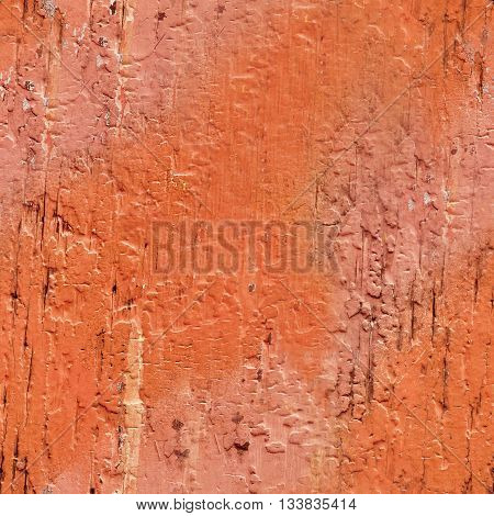A seamless pattern made from a photo of a vibrant background texture of crackled wooden boards with strokes of pink and red paint