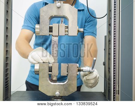 engineering testing machine tensile strength test in preparation stage poster