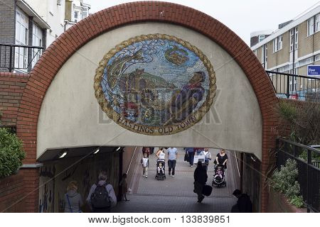 Hastings England - May 21 2016: The mosaic of the old town of Hastings in England on a small bridge.