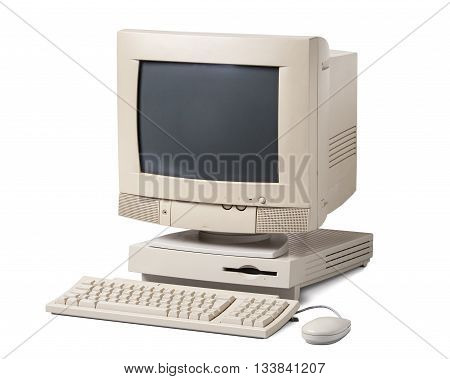 Old personal computer. The system unit CRT monitor keyboard and mouse isolated on white background.