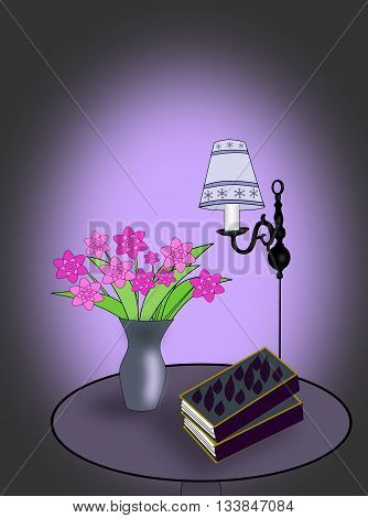 A round table with some books, a lamp, and a vase of flowers.
