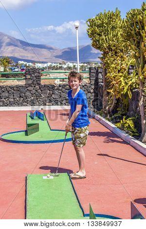Boy Loves To Play Mini-golf