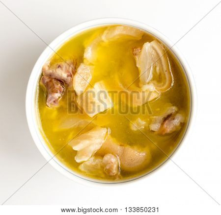 Bowl with bouillon isolated on white background.