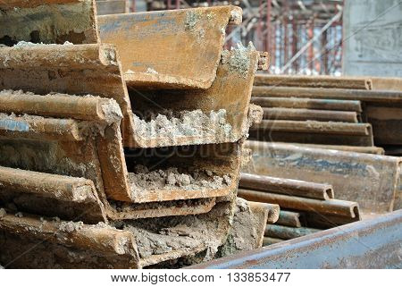 MALACCA, MALAYSIA -SEPTEMBER 25, 2015: Temporary steel sheet retaining wall using sheet pile cofferdam method holding outside soil from collapse into pile pits.
