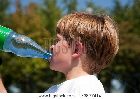 Boy Is Sweating And Thursty  And Drinks Mineral Water